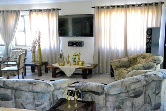 Lounge with LCD TV and Surround System