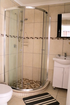 Suite 5 Bathroom, Shower, Wash Basin, Mirror, Toilet, Shower Carpet.