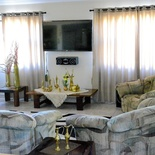 "Anchorage Guest House - Main Guest Lounge Seating Area, 55"" Led Full HD TV, Full DSTV Bougette"
