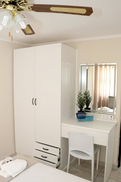 Standard Double Room 2, Wardrobe, Drawers, Chair, Mirror.